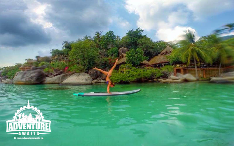 Julia Cobban doing a handstand on her SUP