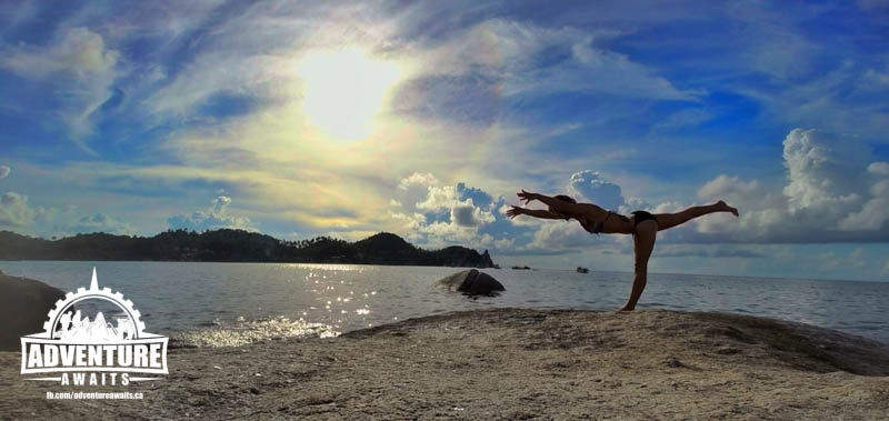 Doing yoga on the beach