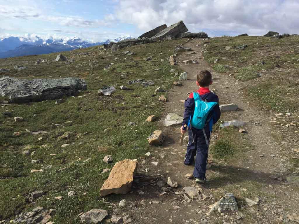 boy-hiking-on-trail