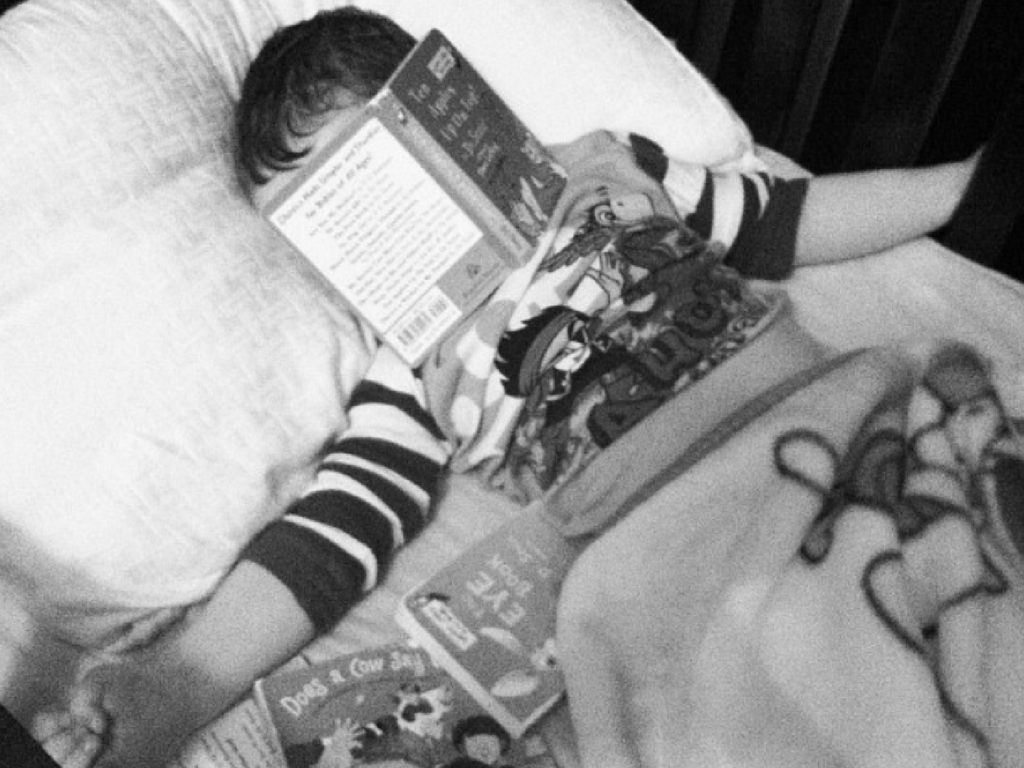 boy-sleeping-in-with-book-on-face