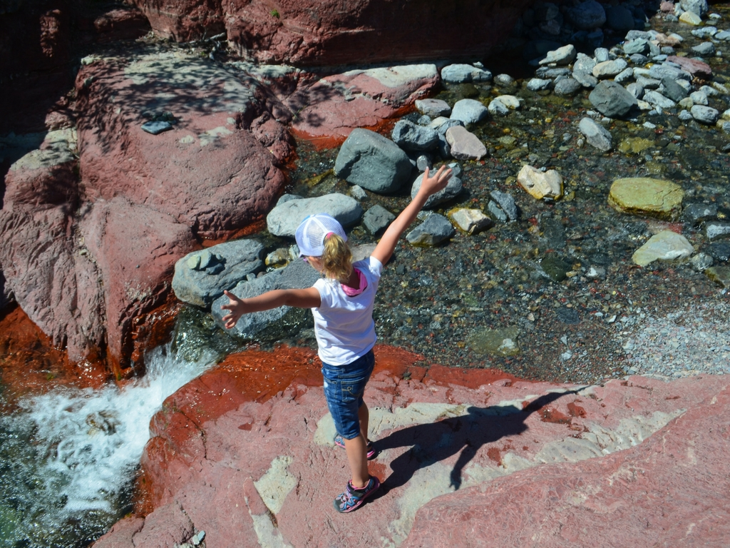 Girl at red rock canyon in Waterton Lakes National Park