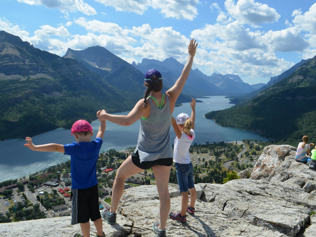 Jami Savage and kids posing on the top of Bear's hump hike in Waterton Lakes National Park