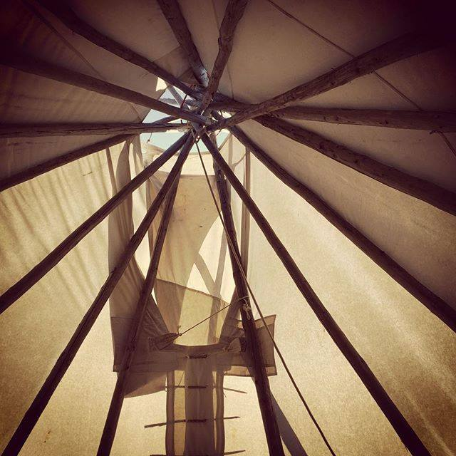 Looking up at the roof of a tipi
