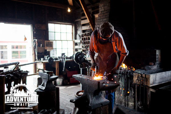 The blacksmith was a creative craftsman. During our visit he was making roses! Photo credit: Heritage Park.