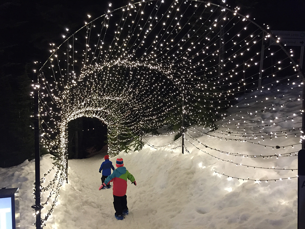 Grouse Mountain Light Walk Kids walking through light tunnel