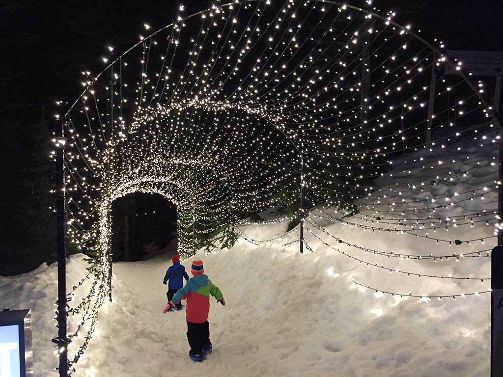 Grouse Mountain Light Walk  Kids walking through light tunnel