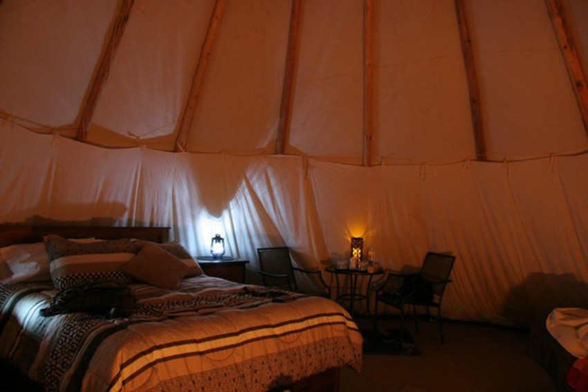 This cozy tipi is the perfect glamping accommodations at the YD Guest Ranch. Photo credit YD Guest Ranch.
