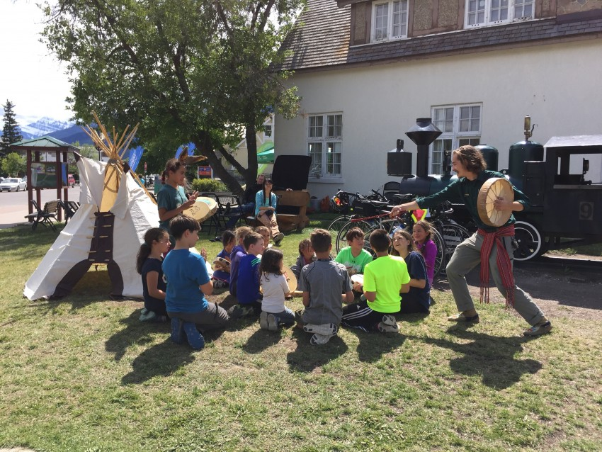 Kids playing the drums for the parks xplorers program