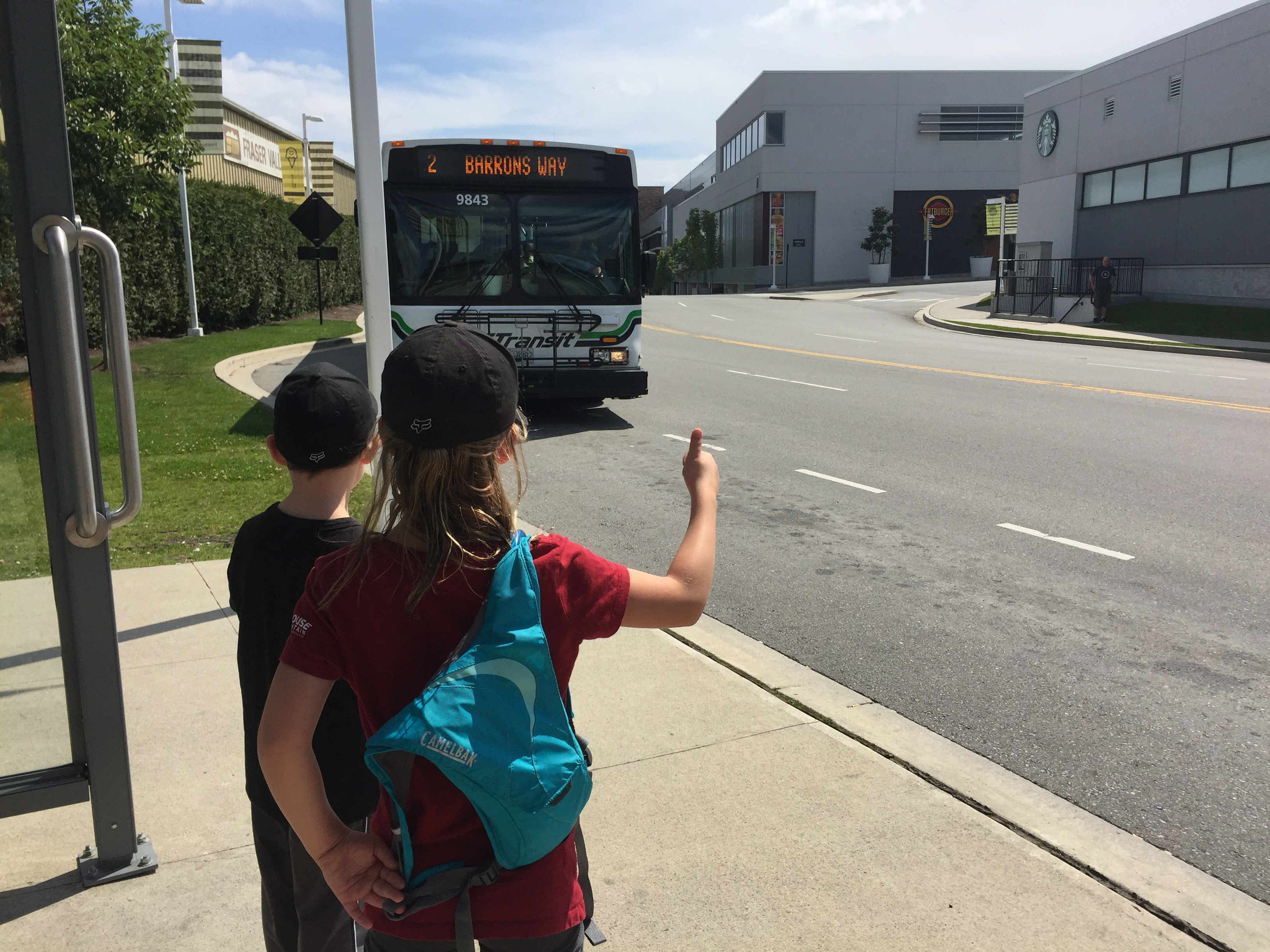 Children waiting at the Bus in Abbotsford for the explore bc by bus campaign