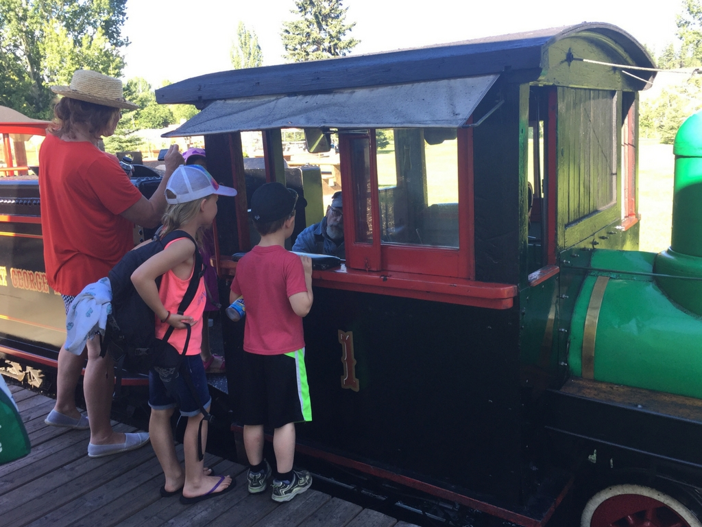 Kids talking to train conductor