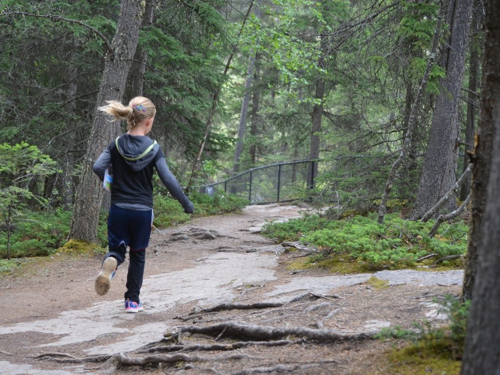 Girl running in Jasper National Park