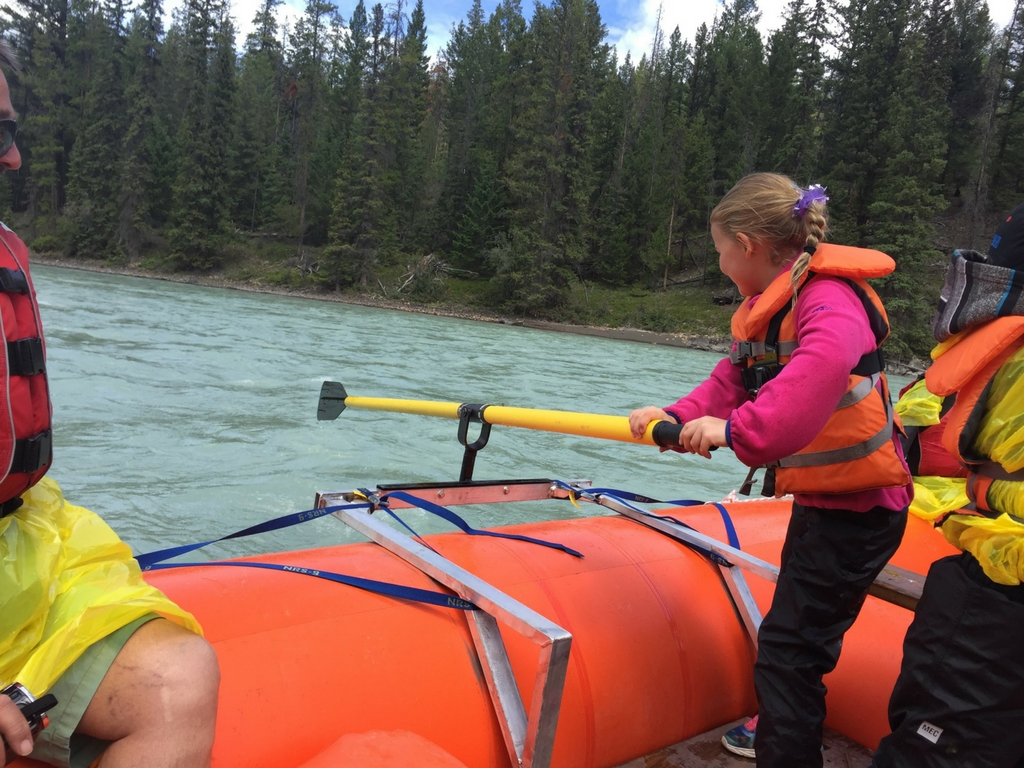 Kids driving the Jasper Raft Tours boat
