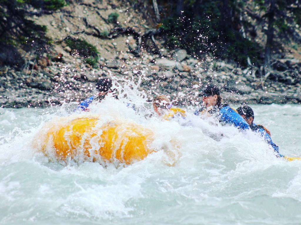white water rafting through a rapid