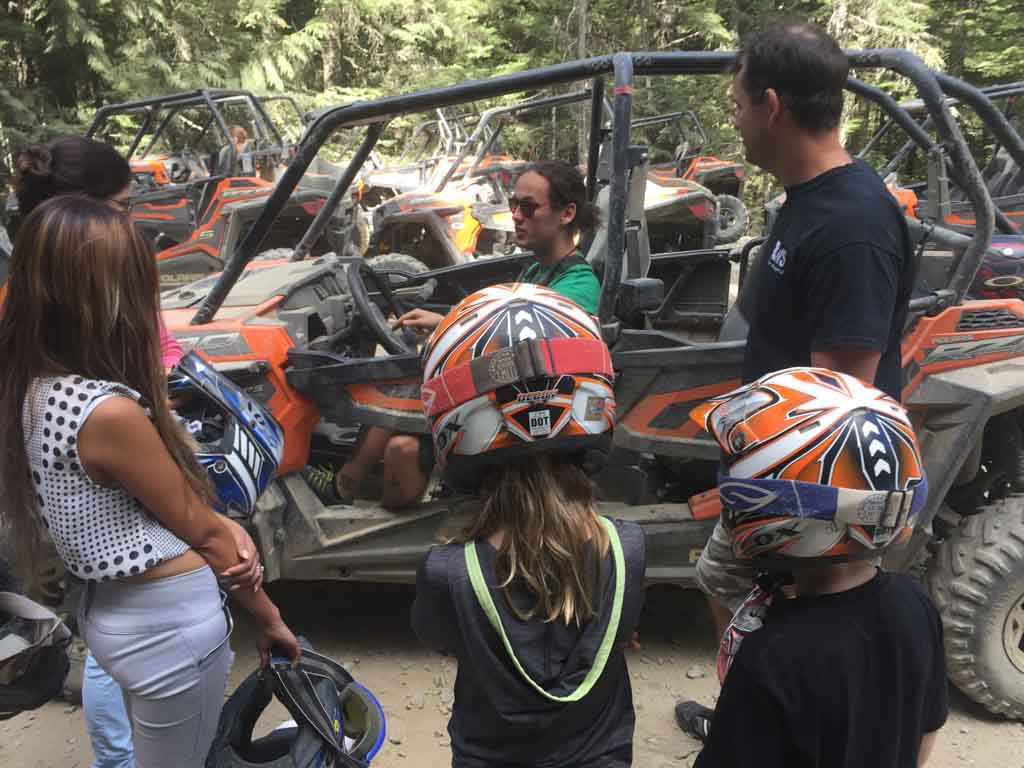 family listening to safety briefing before Whistler ATV Tours