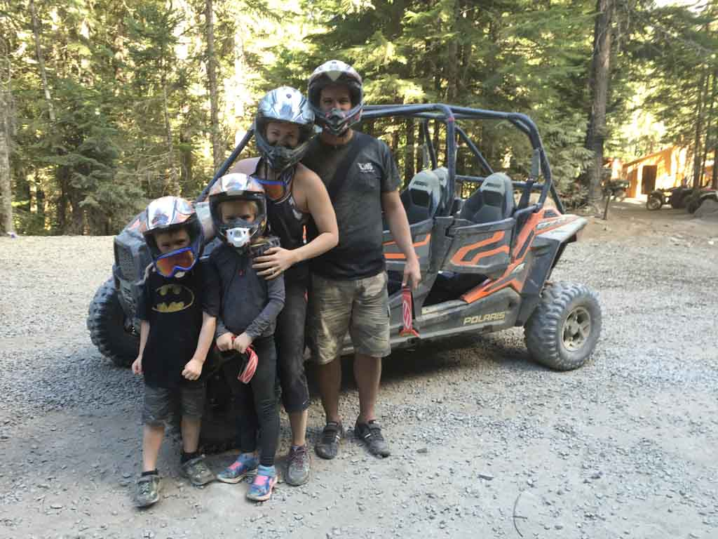 Jami Savage and family posing before beginning their ATV tour in Whistler