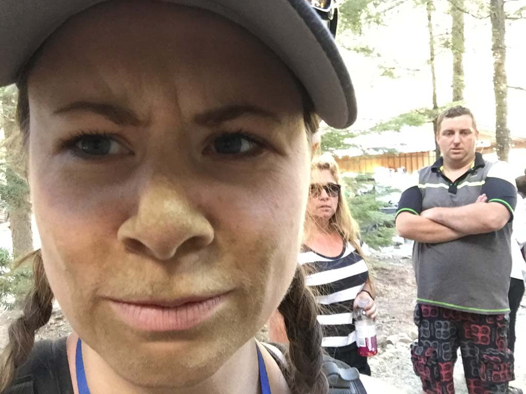 woman with dirt covered face after Whistler ATV Tours