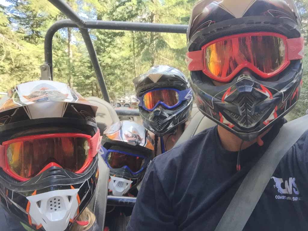 family sitting in RZR during Whistler ATV tours