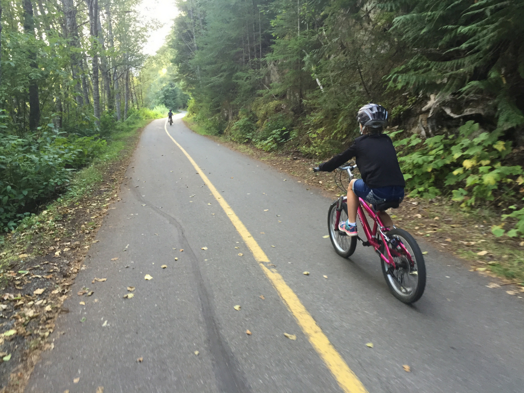 Kids biking on Whistler bike trail