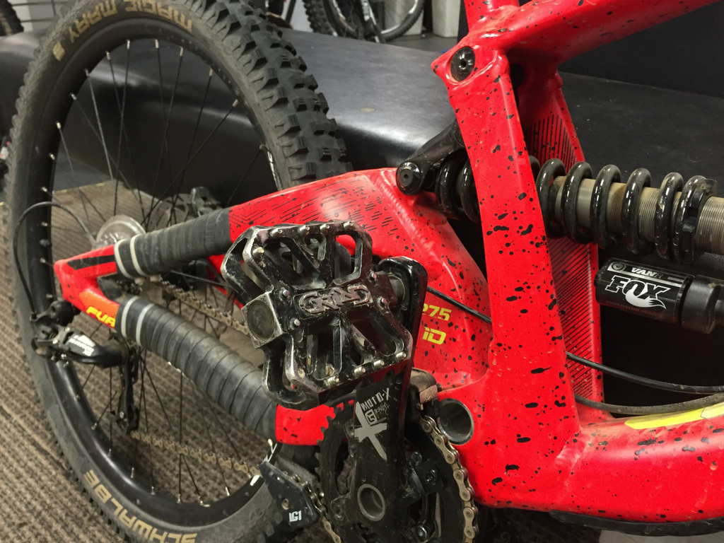 close up of mountain bike pedals and gears