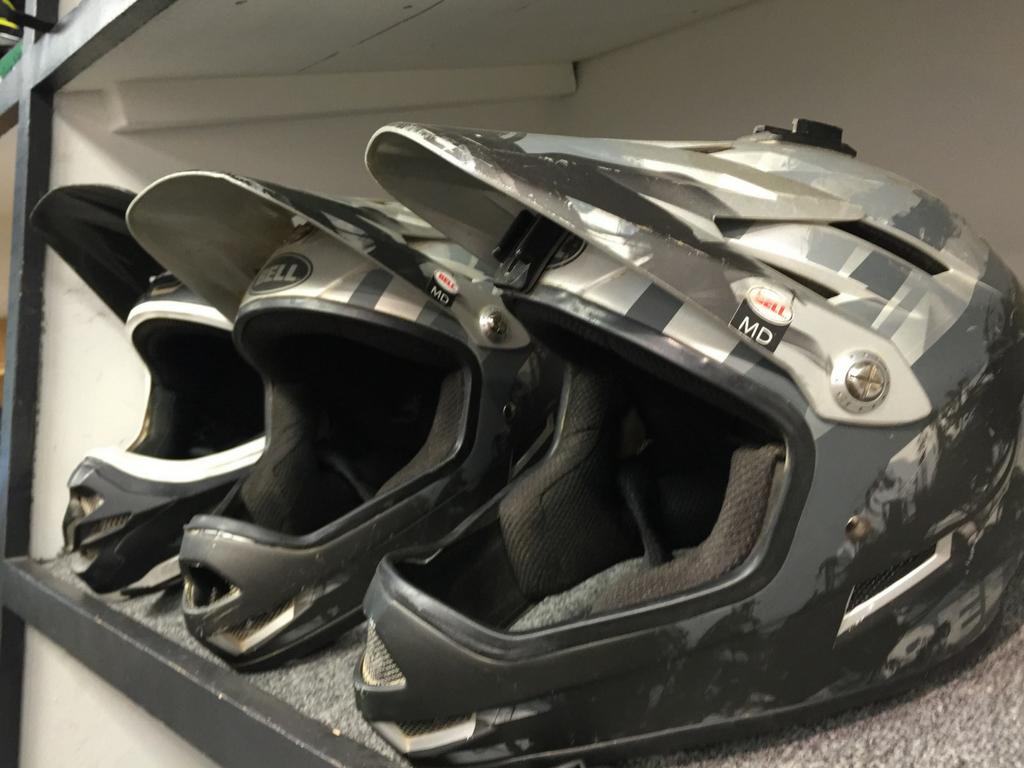 helmets lined up on a shelf