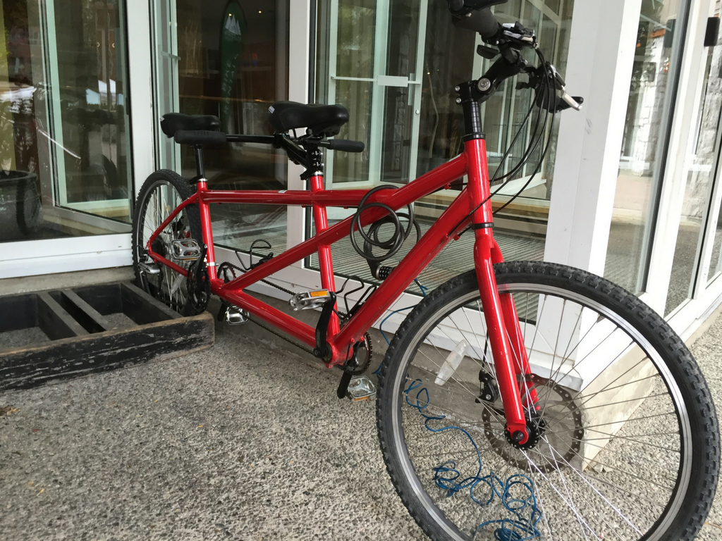 red tandem bike outside of Whistler Sports Rental storefront