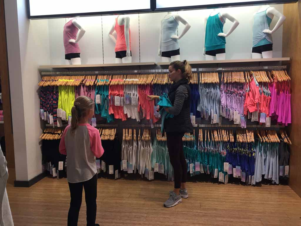 learning about the clothes at Ivivva Metrotown