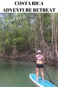 woman stand up paddle boarding at the run like a girl adventure retreat in costa rica