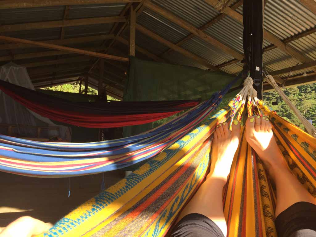 relaxing in a hammock at the adventure and wellness retreat