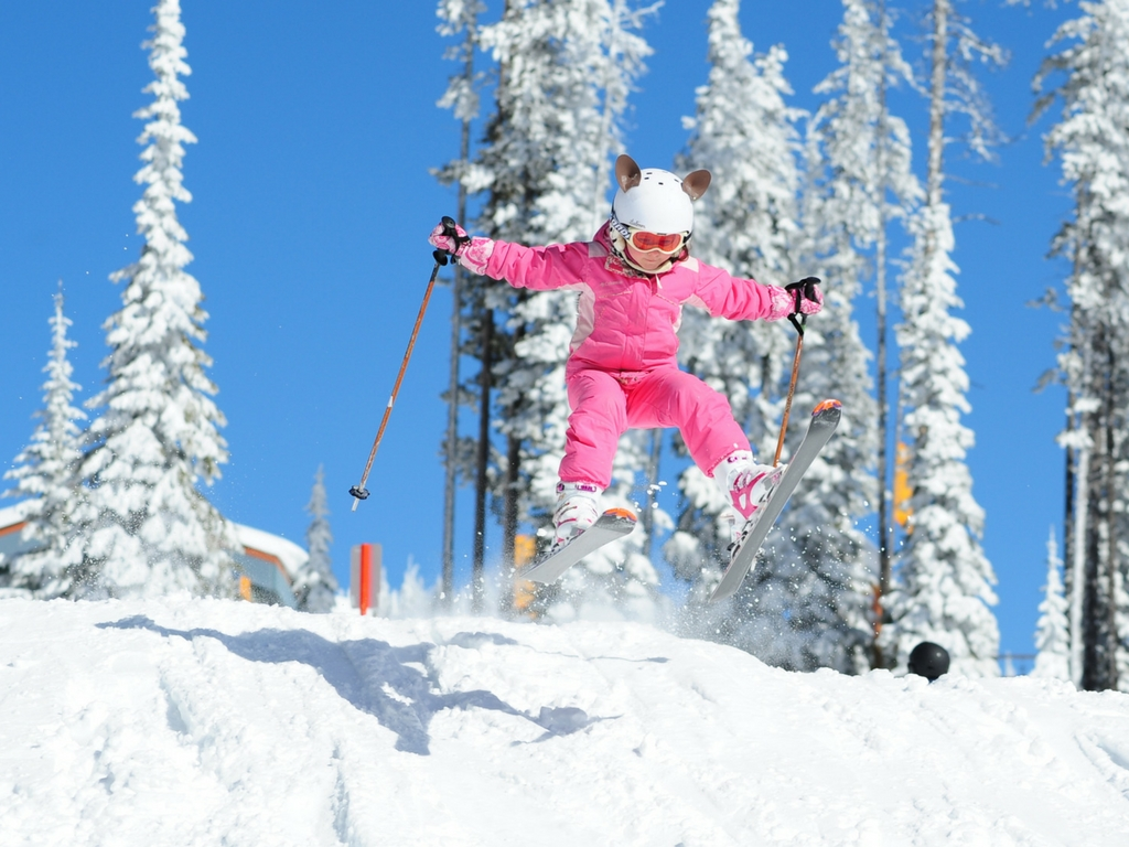 young girl skiing at Big White Resort, one of the best family ski resorts in BC