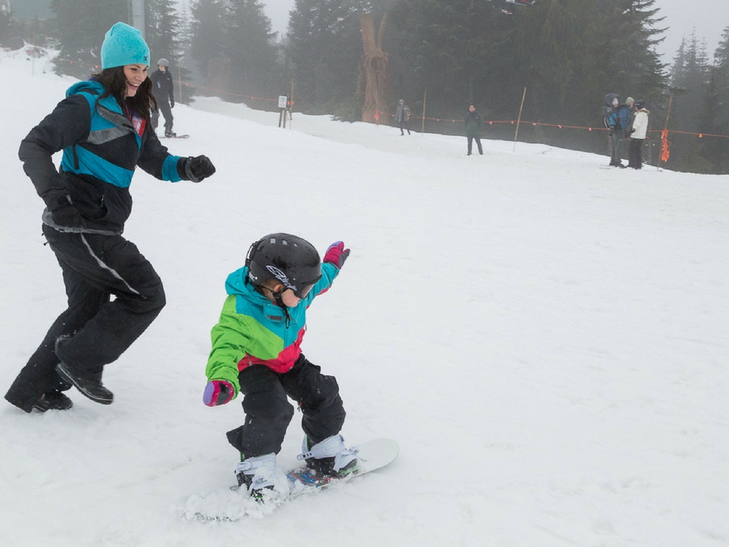family snowboarding on grouse mountain
