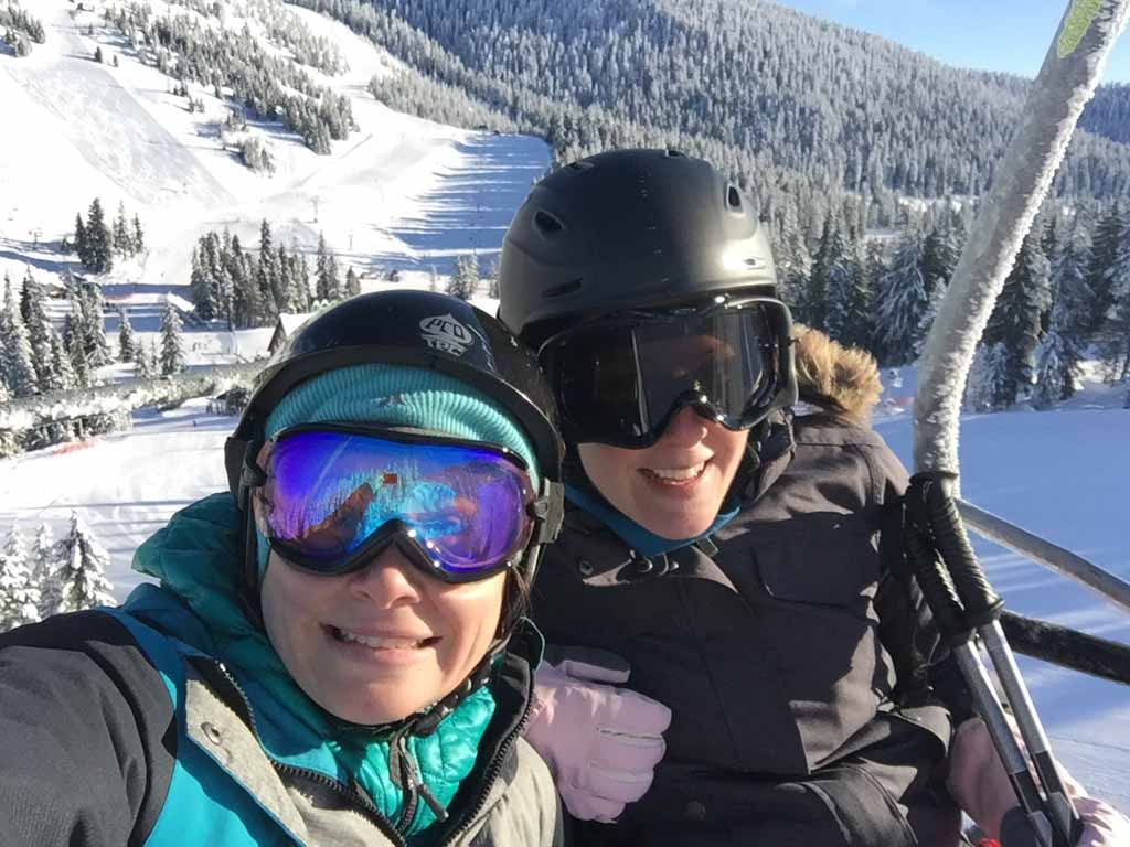 2 women on chairlift on cypress mountain