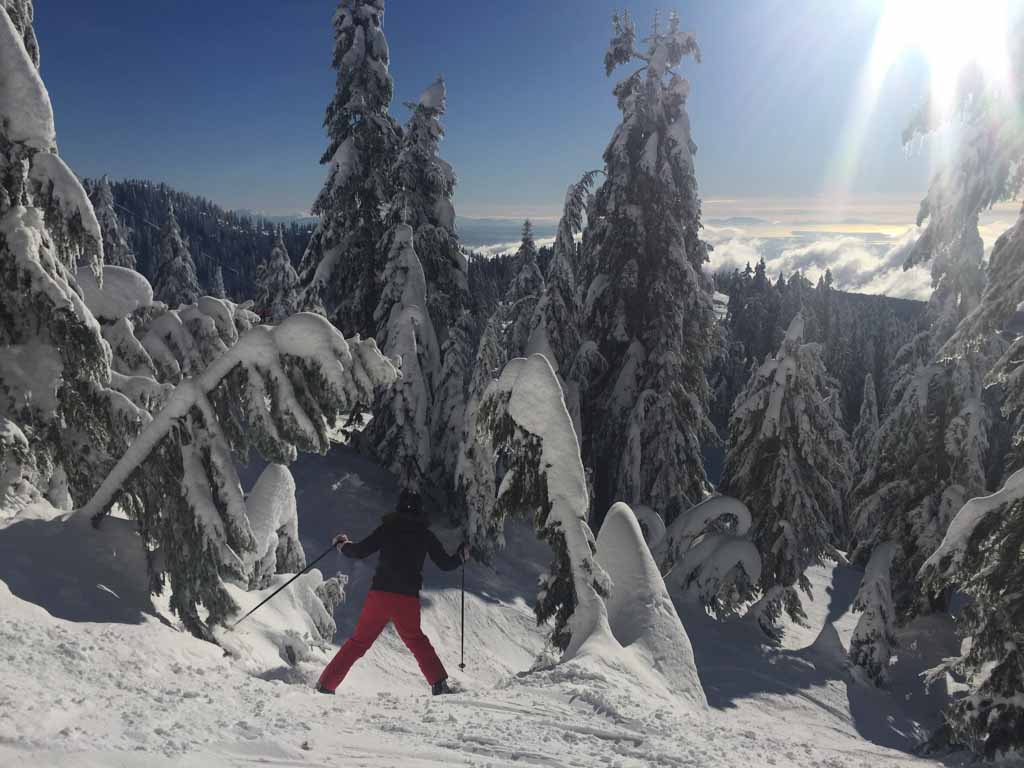 woman skiing on cypress mountain through the trees