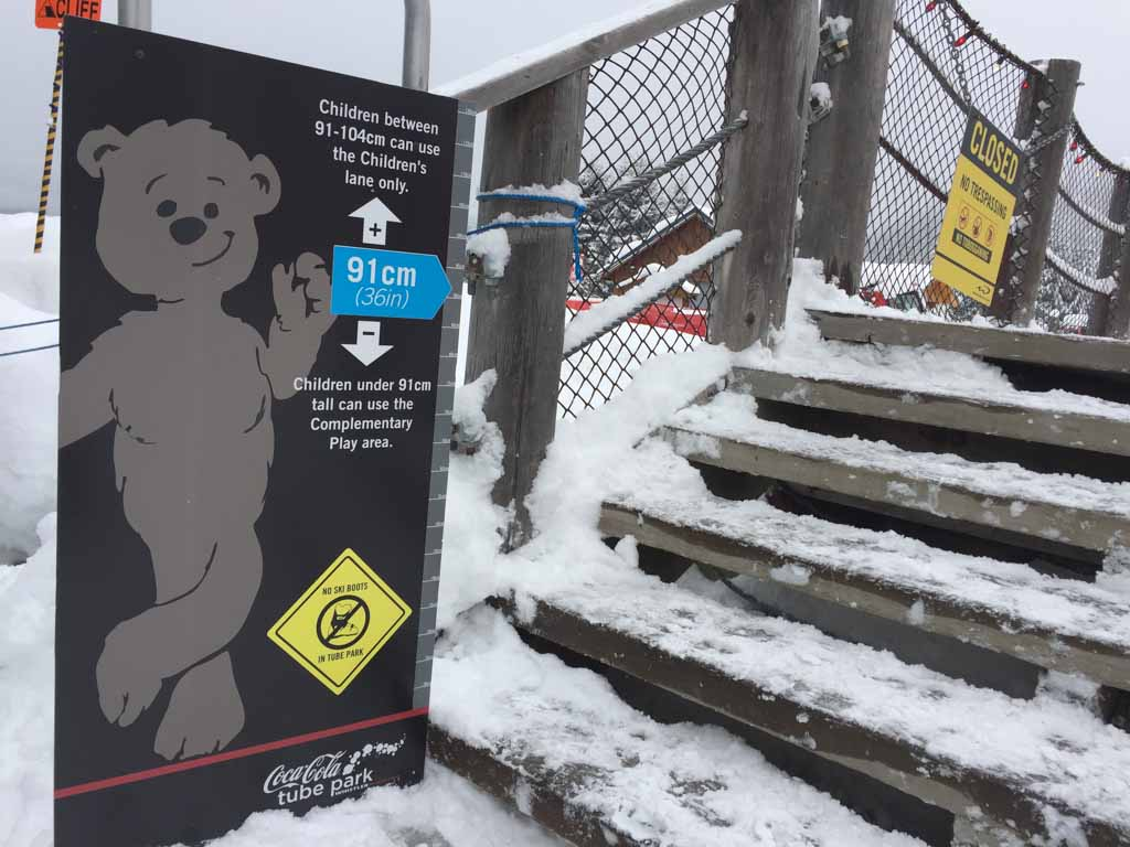 height requirement sign at whistler tube park