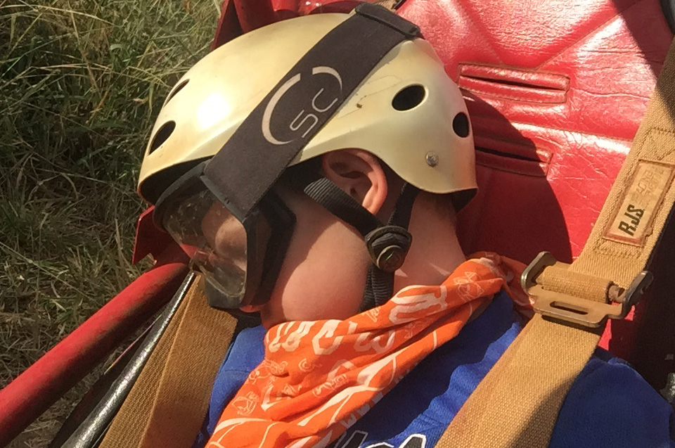 Boy sleeping on the Kauai ATV tour