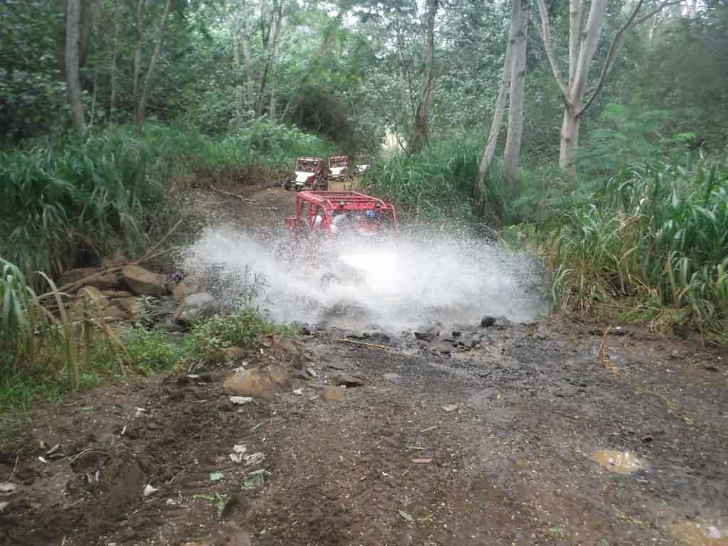 ATV going through the mud on the Kauai ATV tour