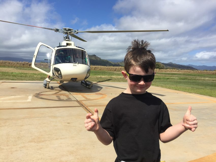 boy waiting to get onto helicopter