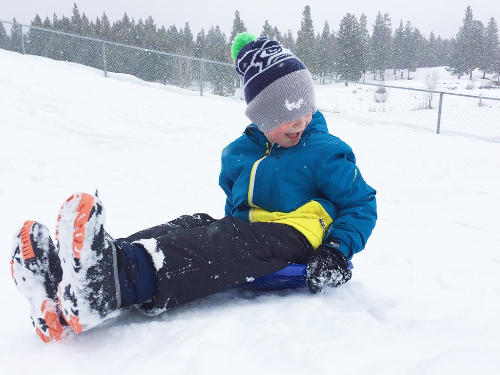 boy-sledding-in-cranbrook