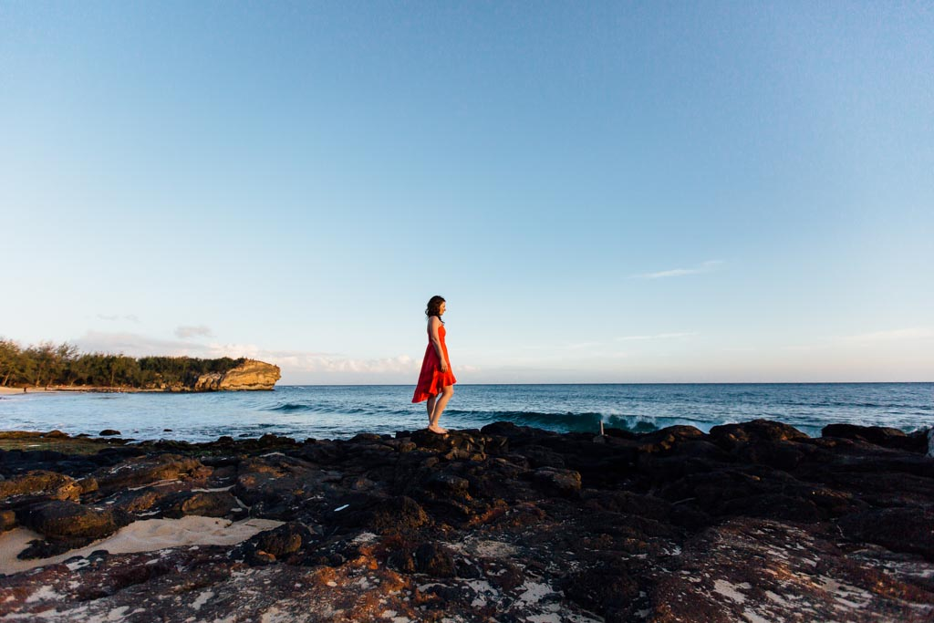 Jami Savage overlooking ocean taken by the best family photographer in Kauai