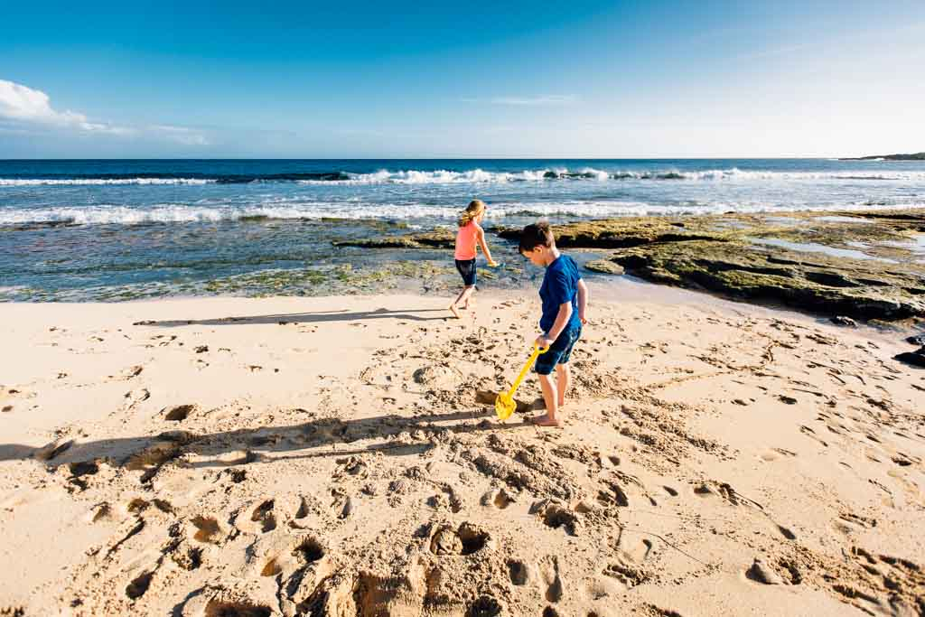 kid-exploring-the-beach-kauai