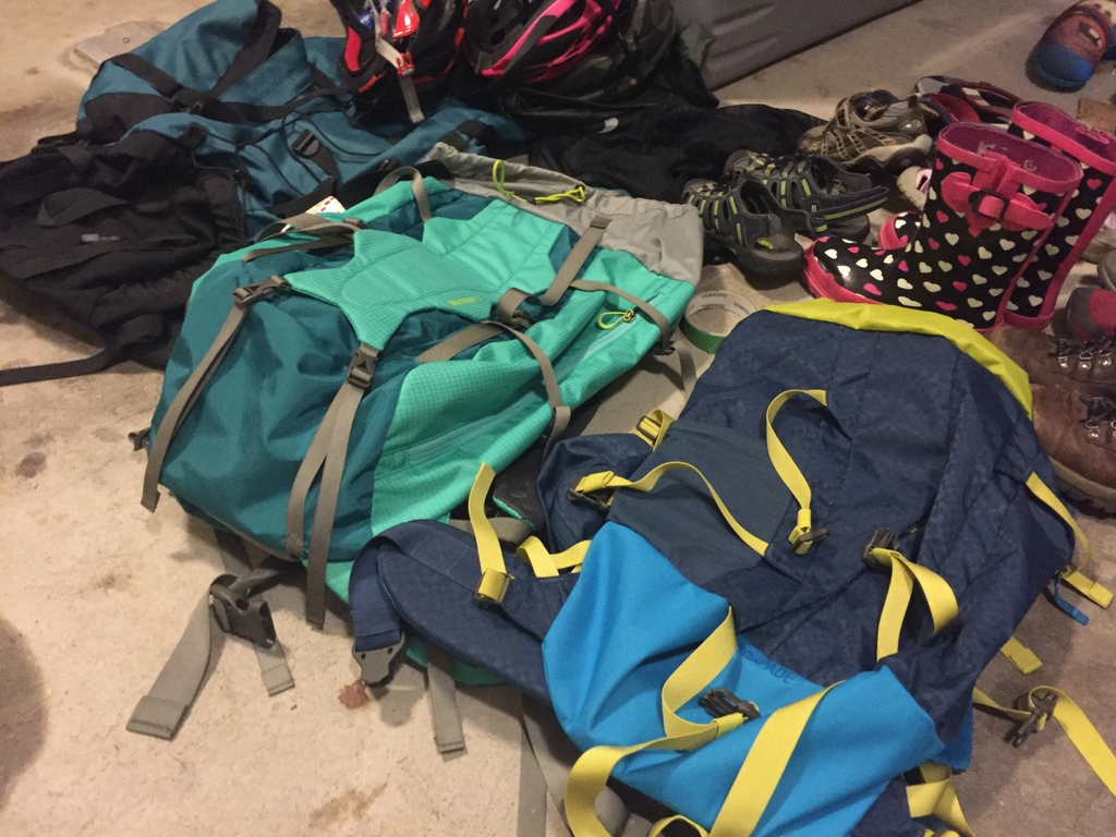 Used backpacks at a flea market for the best deals on outdoor gear