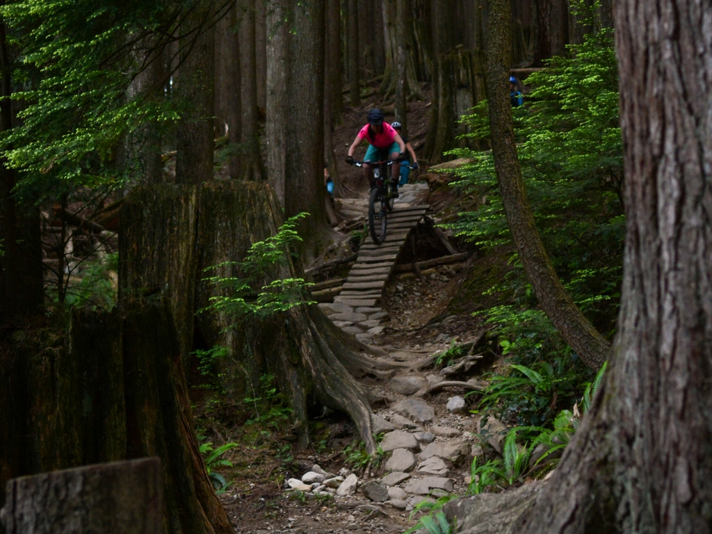 woman-downhill-mountain-biking