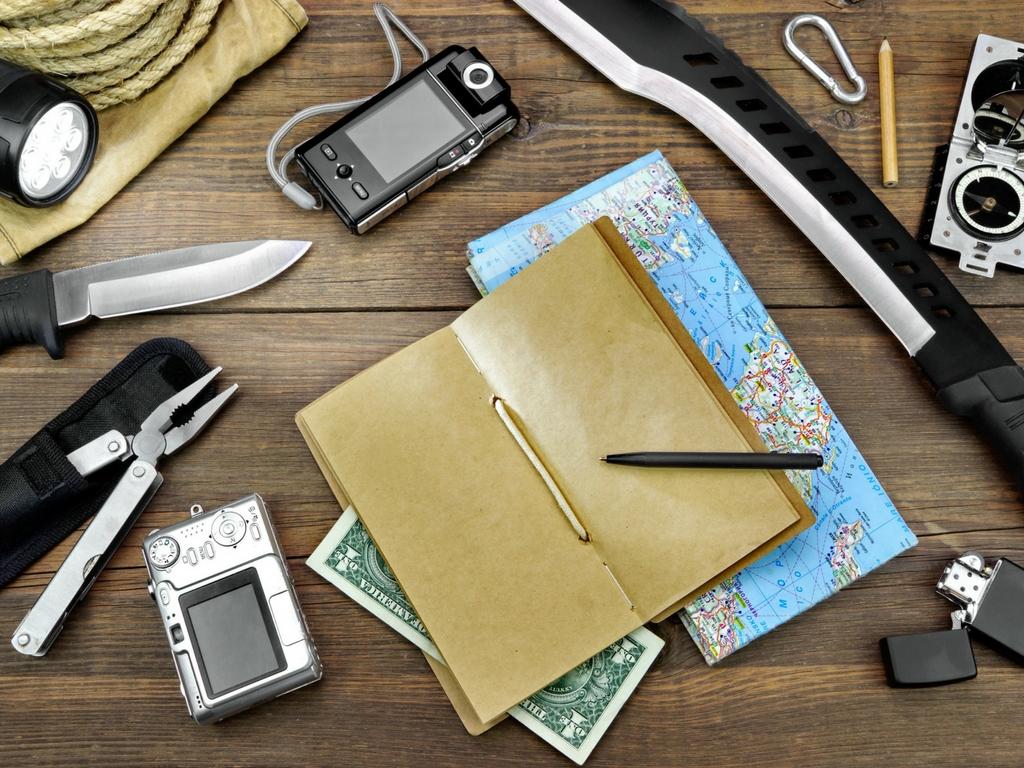 outdoor-essentials-map-camera-knife-compass