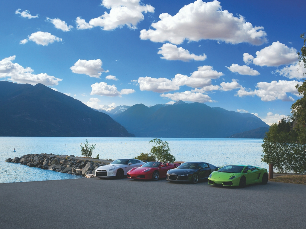 Luxury cars parked at Porteau Cove