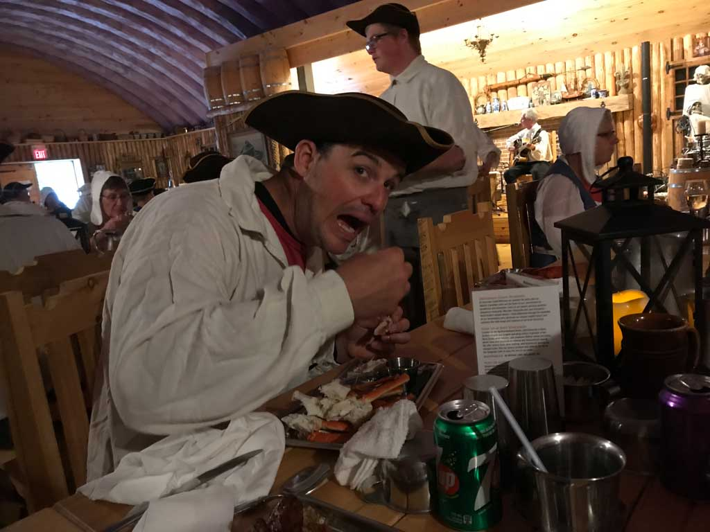 Man eating crab at the Beggars banquet at fortress of Louisbourg