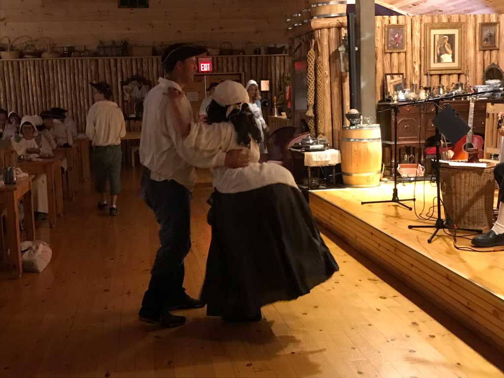 Man and woman dancing at the Beggar's Banquet at Fortress of Louisbourg