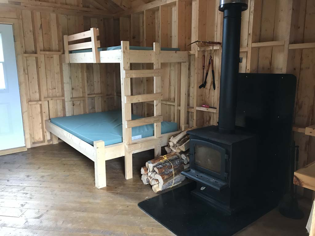 view-inside-rustic-cabin-in-berry-hill-campground