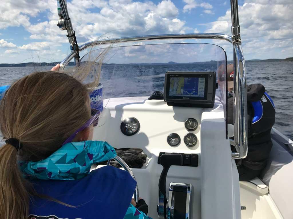 girl-driving-boat