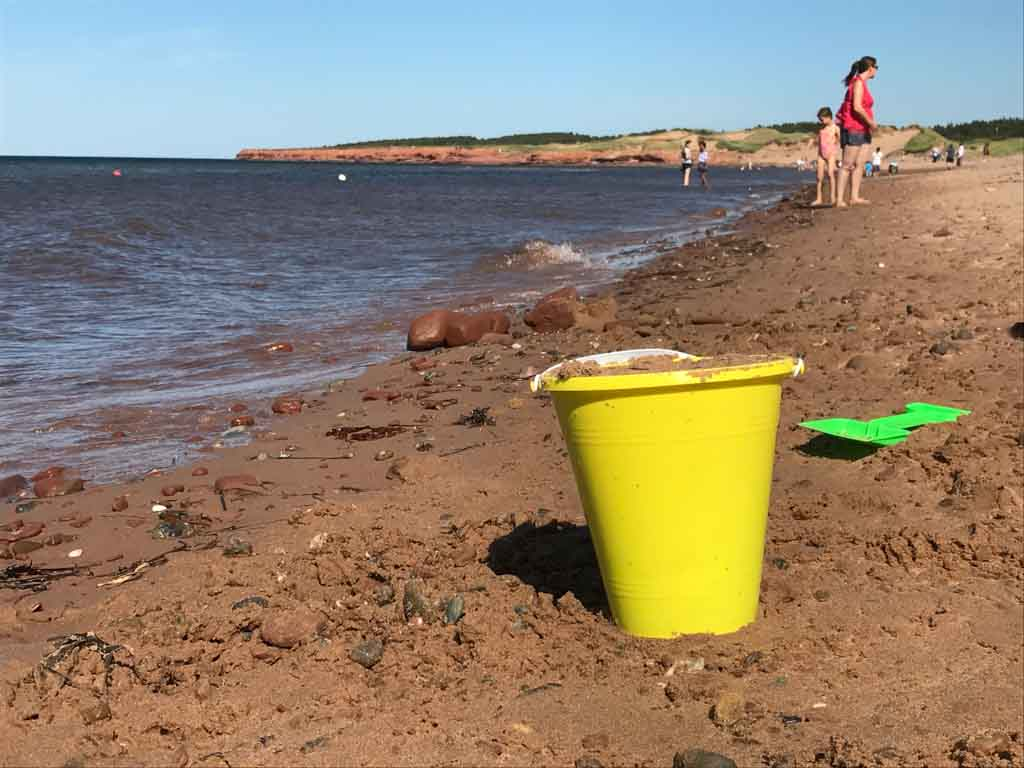 Kids playing on the beach in the PEI national park
