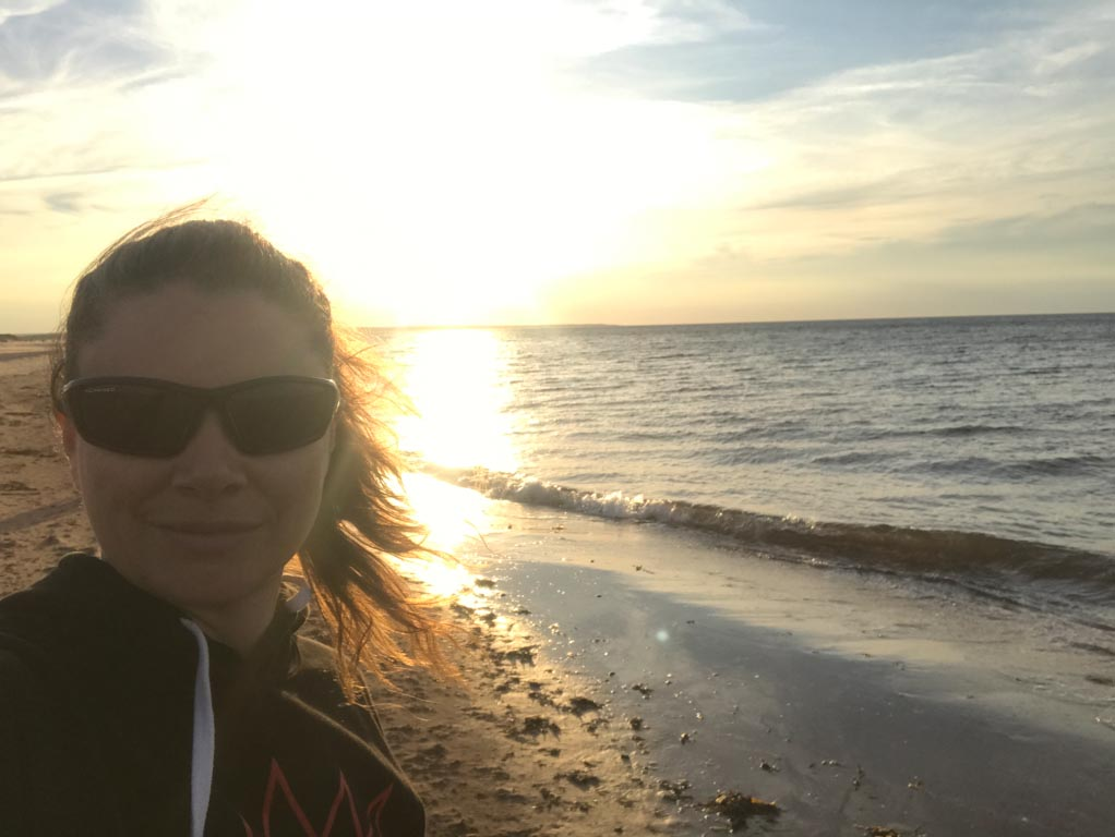 Jami Savage on the beach in the PEI National Park
