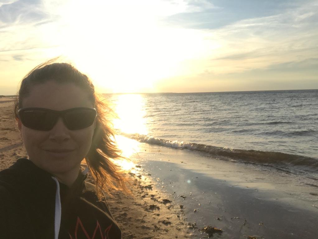 woman-enjoying-pei-sunset